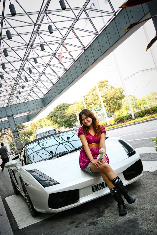 white lambo and a girl