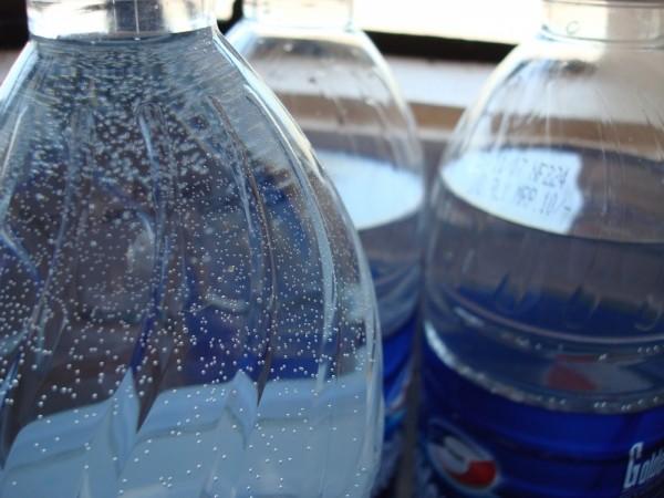 Bubbles inside bottle of mineral water