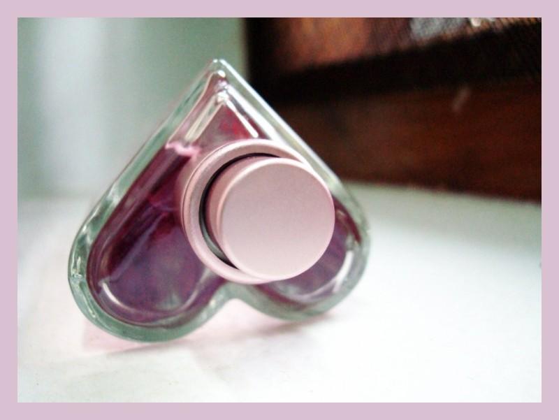 A heart-shaped perfume bottle