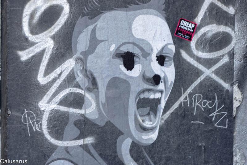 Graffiti affiche rue Amsterdam