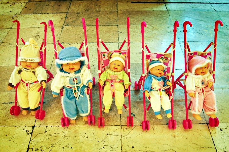Baby Dolls in Pink Strollers