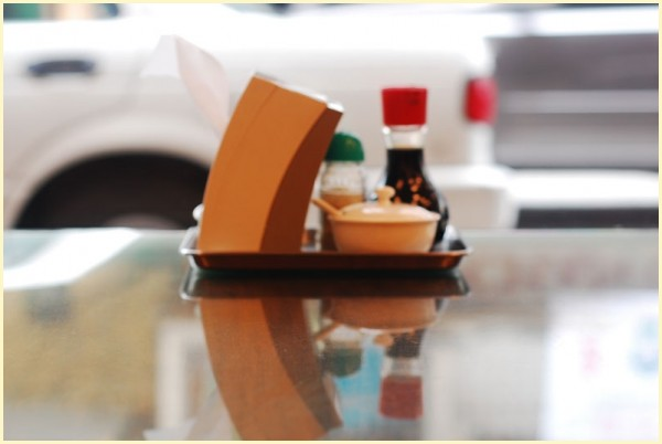 Napkin Dispenser, Condiments, and Their Reflection