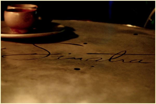 Sinatra Engraved on a Table with Cup and Saucer