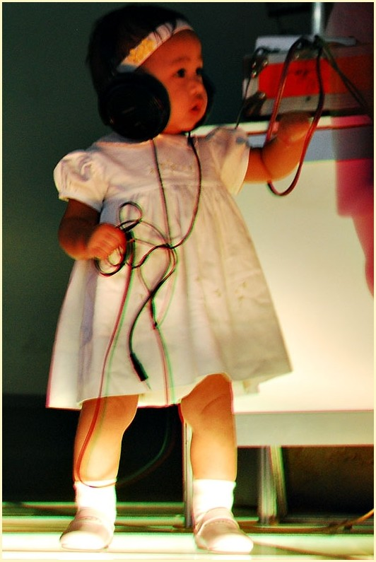 Baby on Stage During a Queso Concert Performance