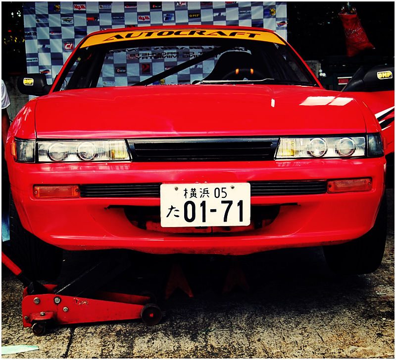 Japanese Plate on a Red Drifting Car
