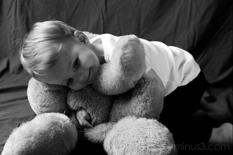 Portrait Child Stuffed Puppy Dog
