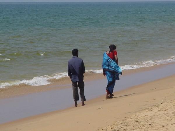 Lovers along  an Indian seashore.