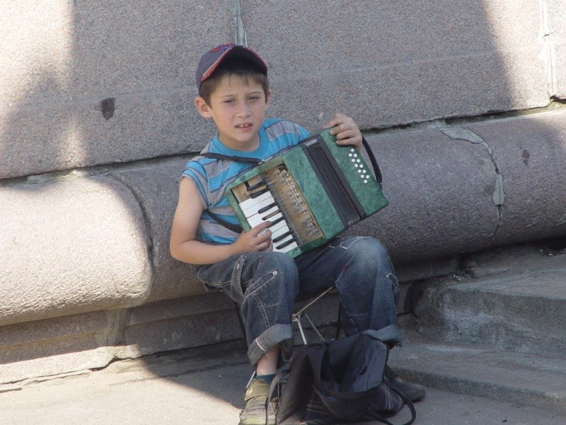 Boy playing Accardeon in Moscow