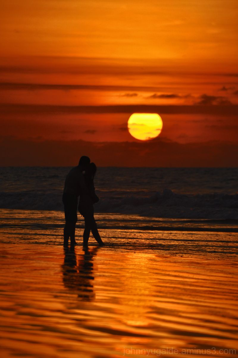 Couple at sunset on the beach