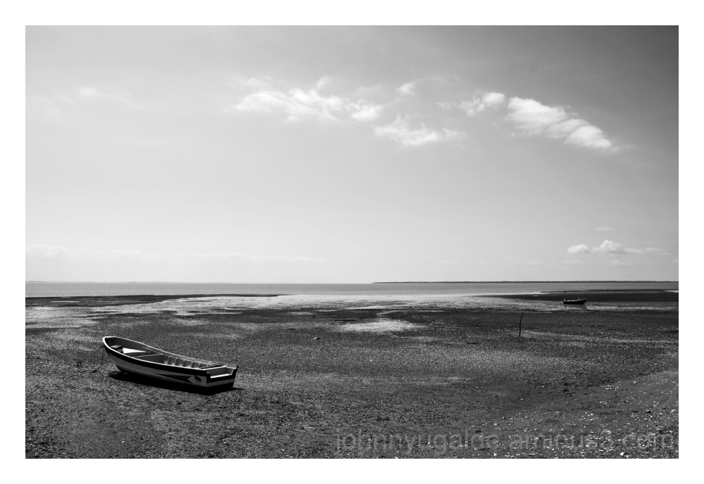 Boats alone on the beach