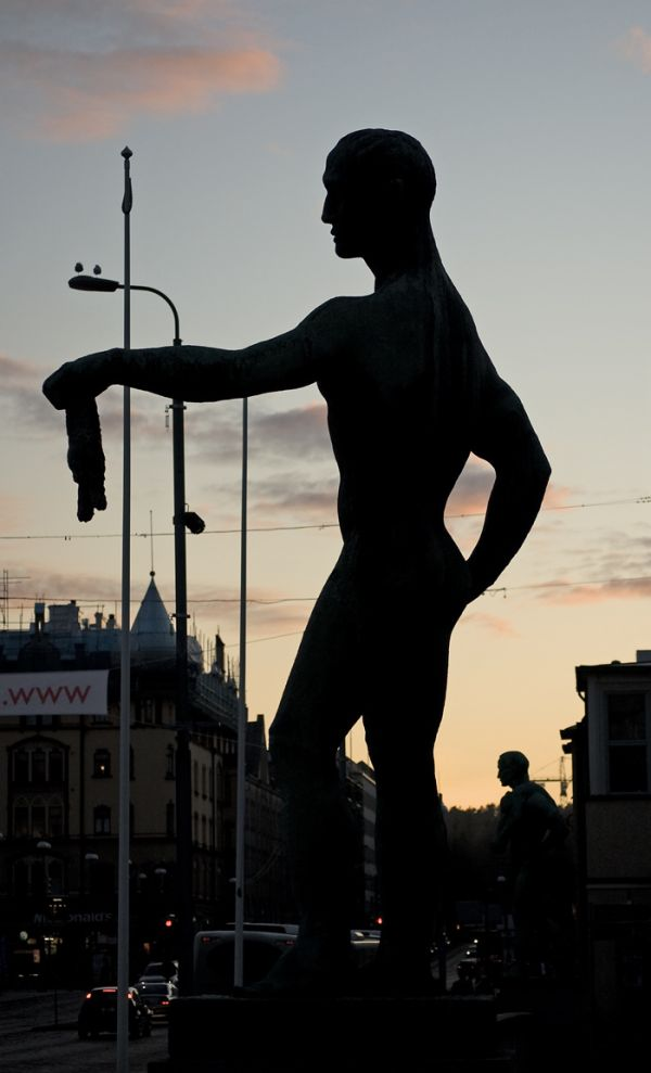 A silhouette of a statue