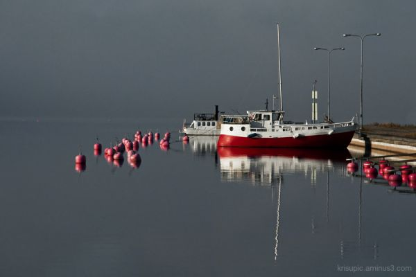 Buoys and boats in grey