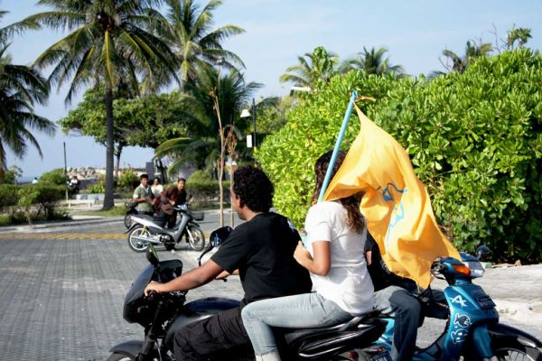 girl with yellow flag ...