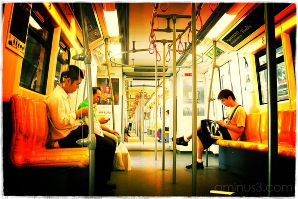 Colorful photo inside a Bangkok skytrain.