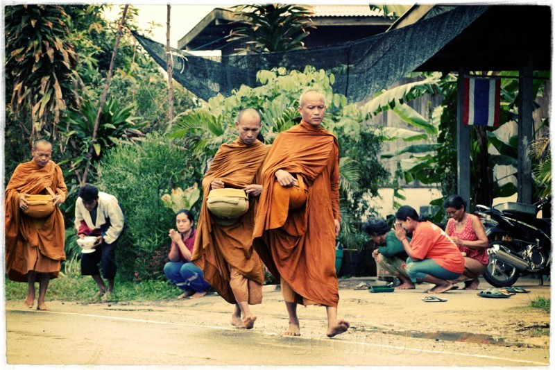 Monks on their walk to receive food gifts.