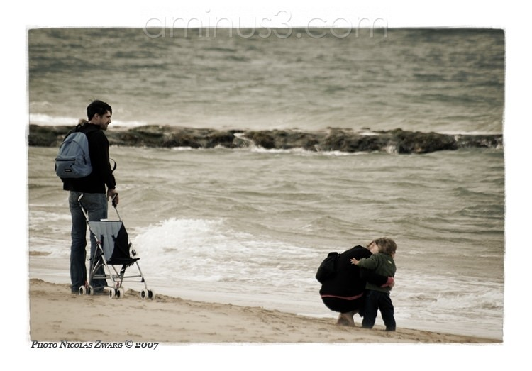 Family walk on the beach, Arcachon, France