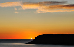 Sunset Caswell Bay Gower Wales UK