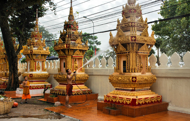 Hose down Wat Stupas Vientianne Laos