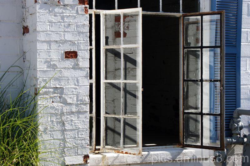 Reflective Window - Blue Shutter