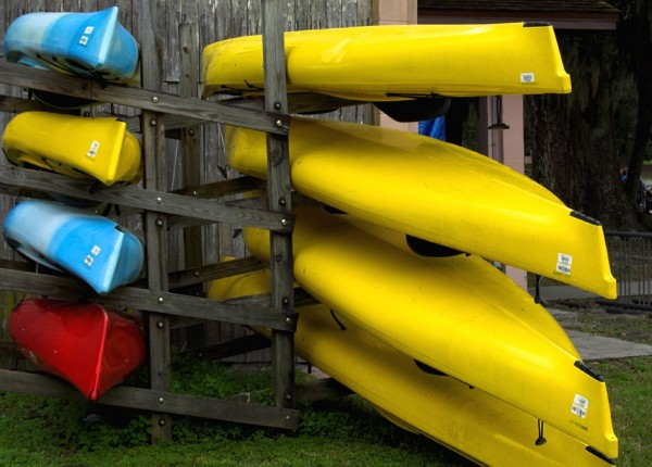 kayaks stacked up for storage
