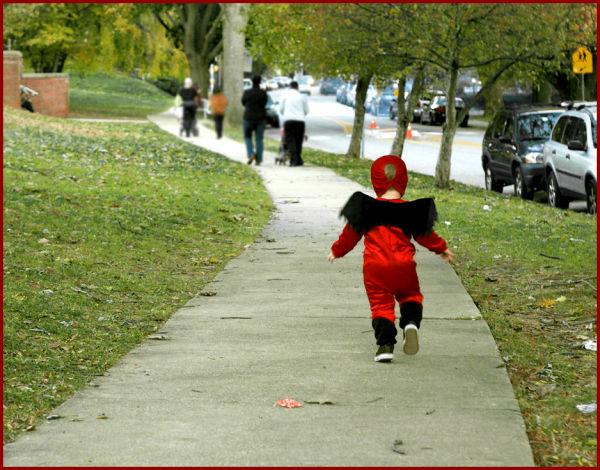 baby running in costume