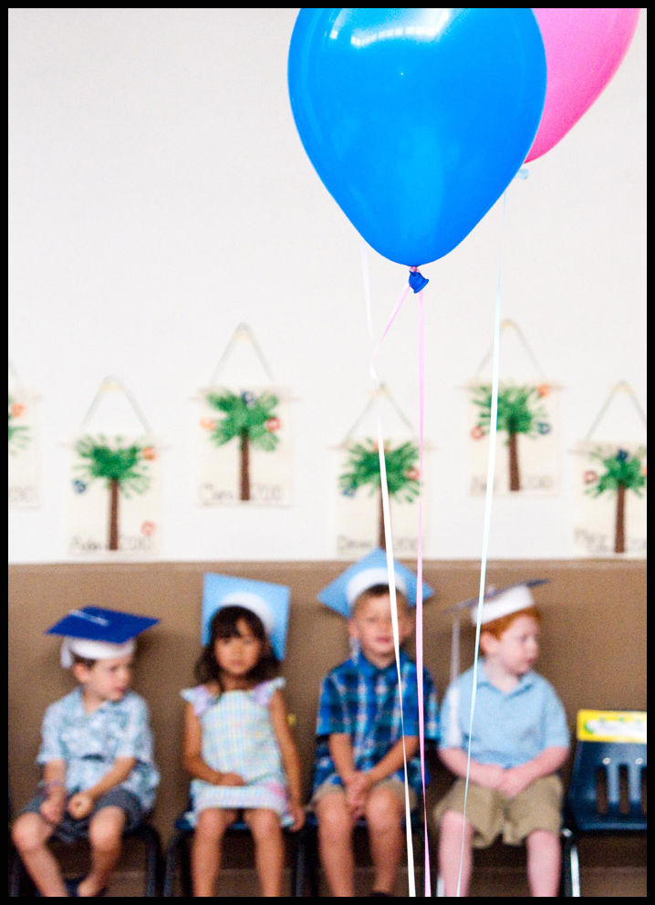 children waiting to get preschool diplomas