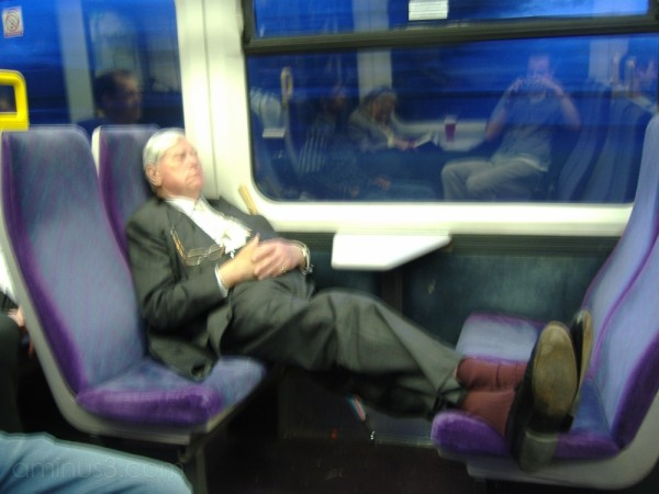 Old man with his feet on the seat