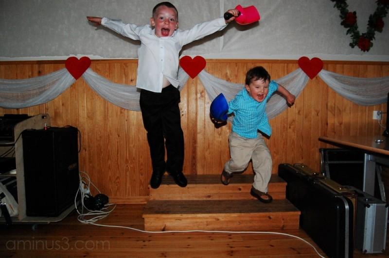 kids jumping at a wedding