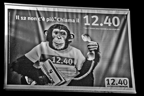 Sign hanging in the train station in Palermo