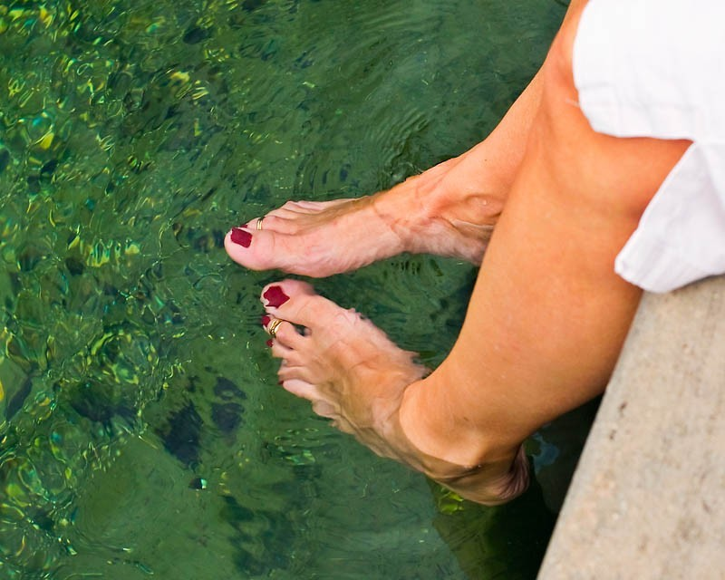 Red Toe nails in water