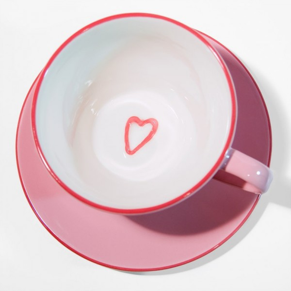 Cup and saucer with heart pattern
