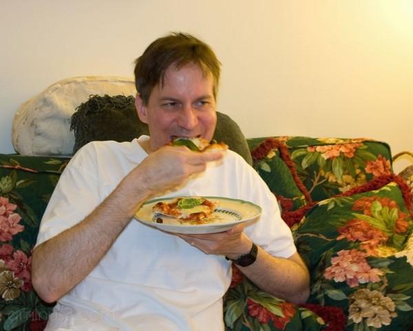 Scott eating pizza