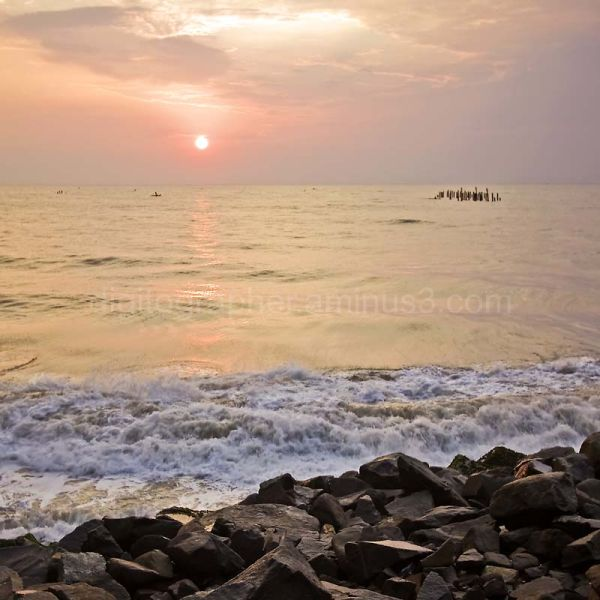 Sun coming up on Pondicherry