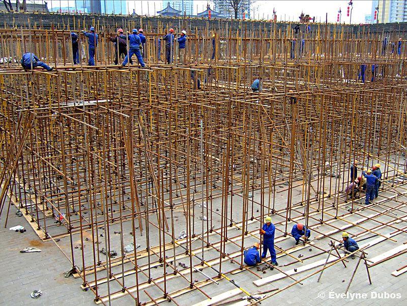 Men at work. (China)