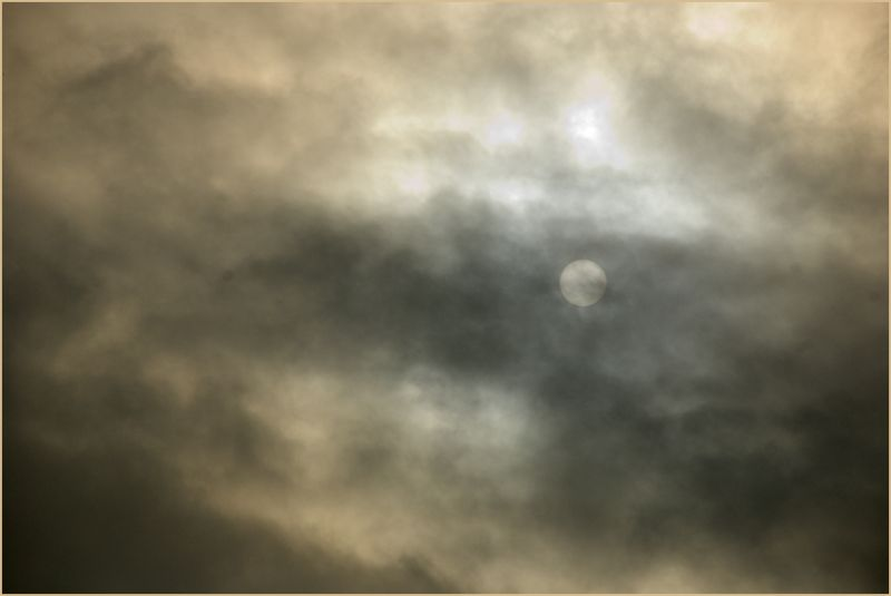 Sun trying to shine through clouds