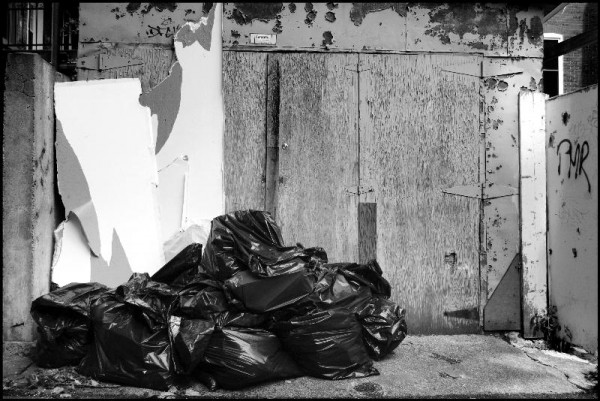 trash in an alleyway in montreal