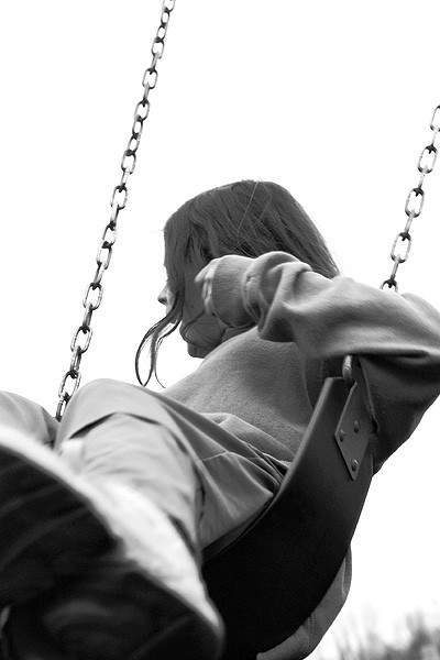 girl swinging at a playground