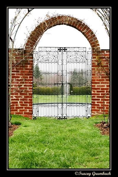 photo of brick arch and iron gates