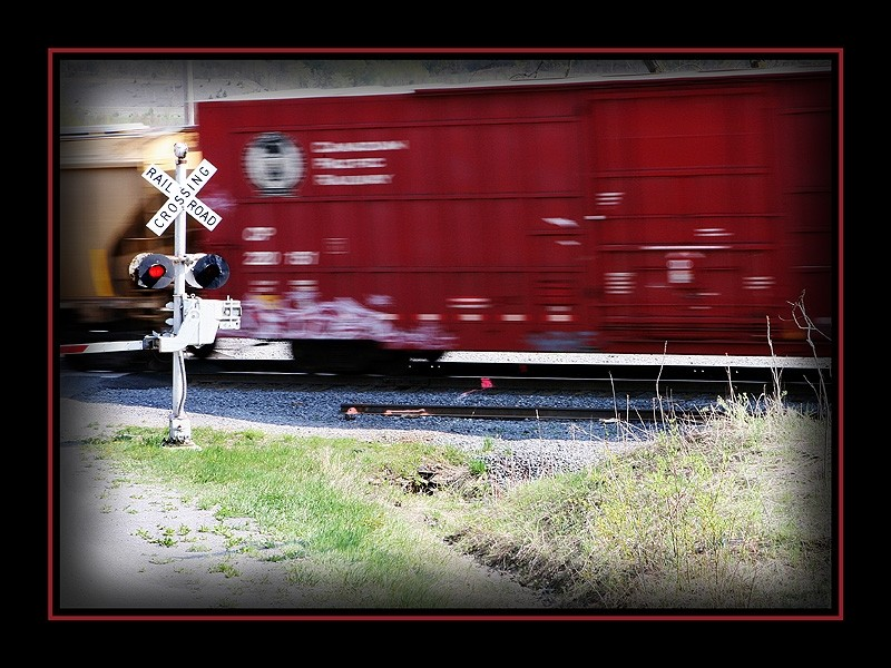 railroad crossing sign with moving train
