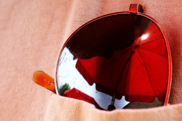 sunglasses with reflection of a beach umbrella