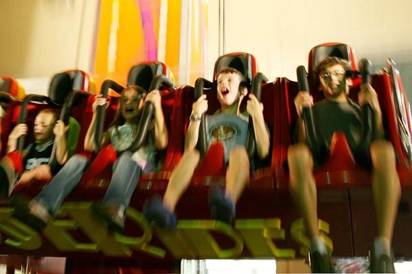 kids on a free fall amusement ride