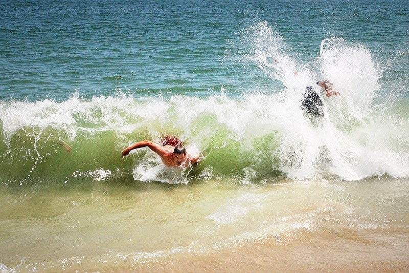 people playing in the ocean