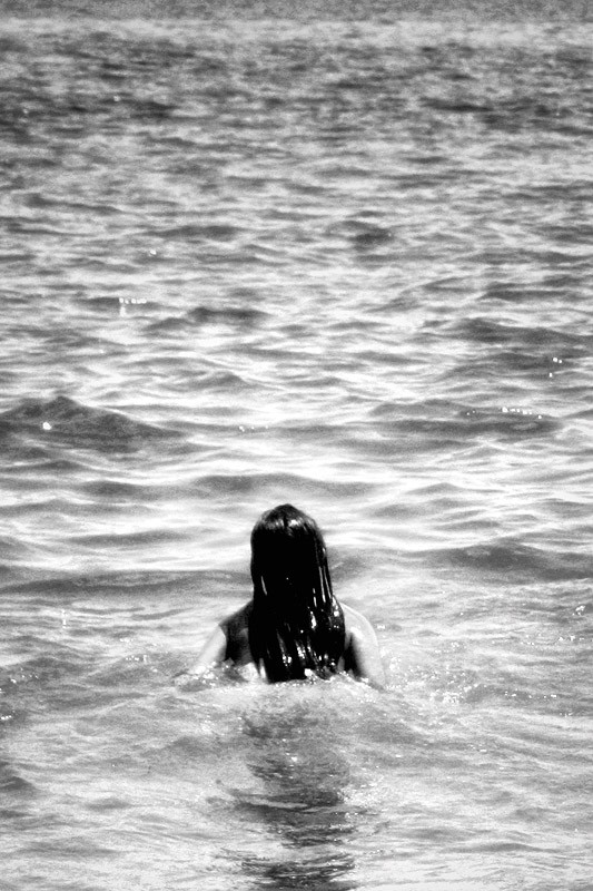 girl's head coming out of ocean water