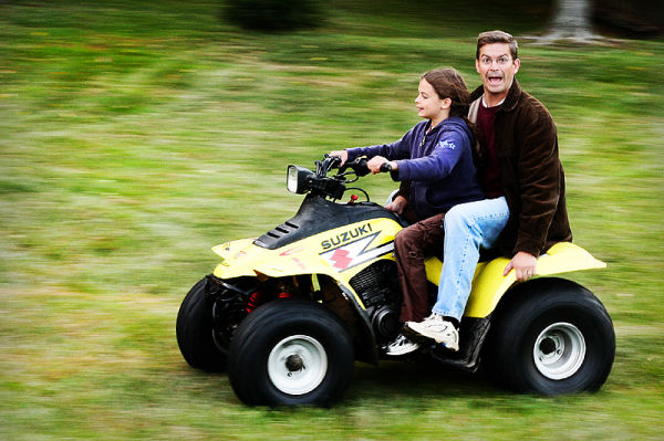father and daughter in a 4 wheeler