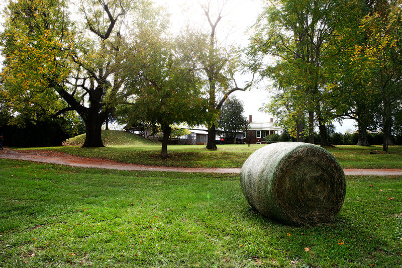 hay bale in front of Poplar Forest