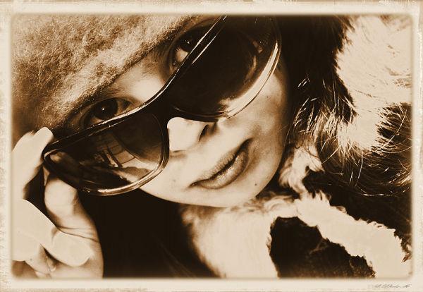 girl peeking over sunglasses
