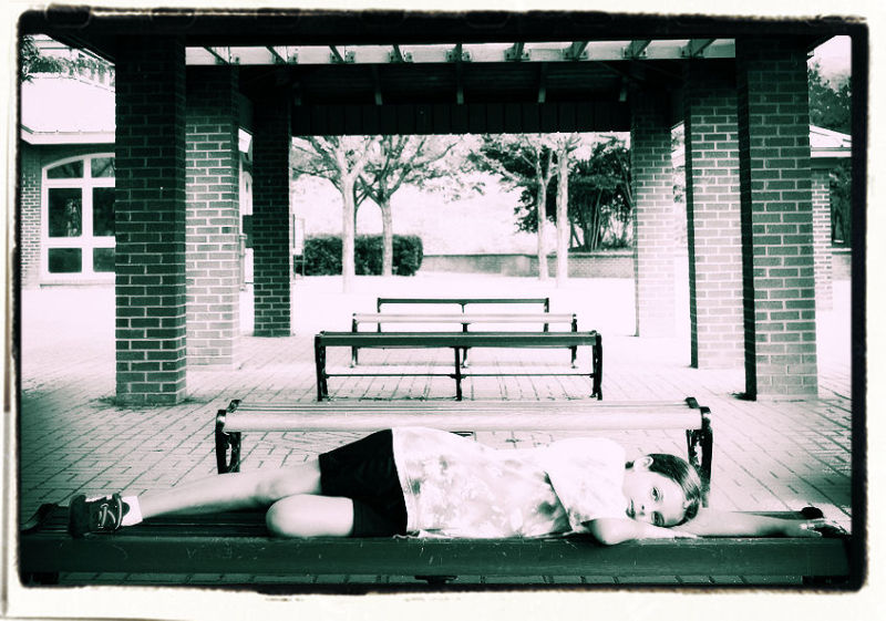 girl laying on benches