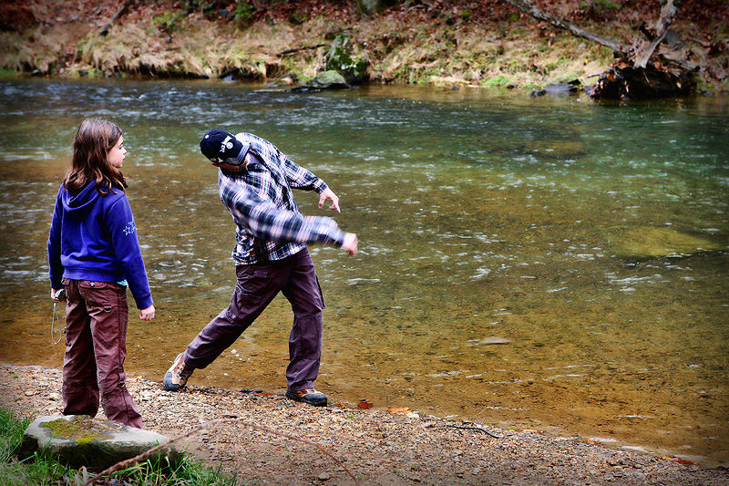 skipping rocks by the stream