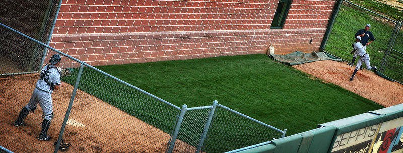 pitcher warming up in bullpen