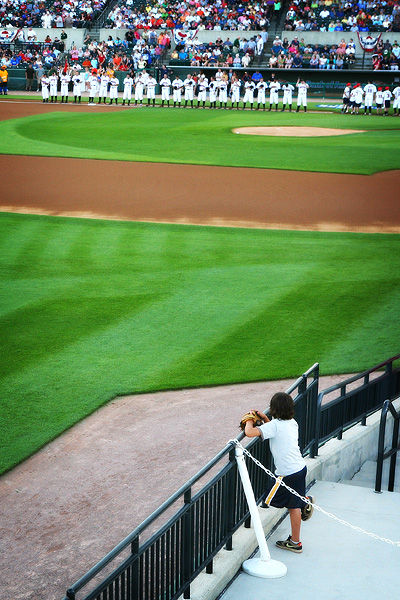 boy watching baseball players